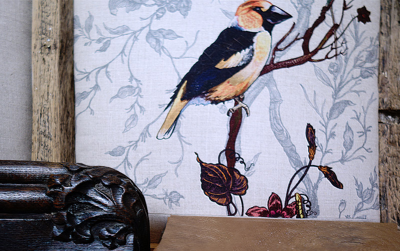 detail floral carving and goldfinch print for wall-paneling