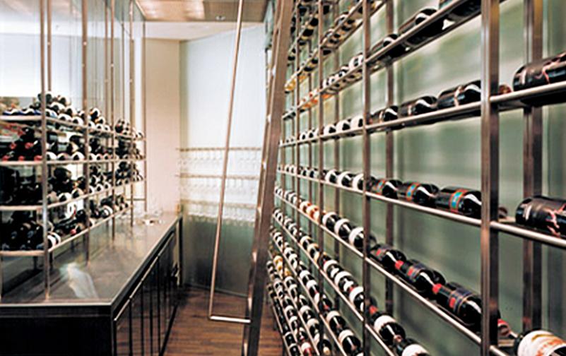 hotel designer for radisson blue public areas showing walk in wine cellar